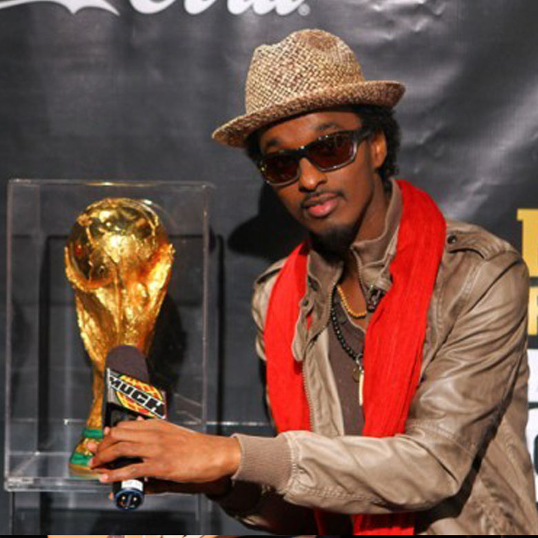 K'Naan with world cup trophy