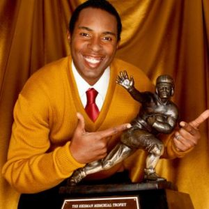 Talented quarterback Charlie Ward posing with his Heisman Trophy.