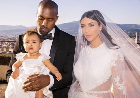 Kim Kardashian and Kanye West with their daughter